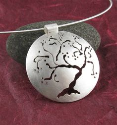 Sterling Silver Cherry Tree Pendant, Handmade. $145.00, via Etsy.