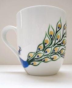 Hand painted peacock on a ceramic coffee mug