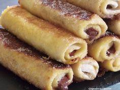 PAIN DE MIE ROULE AU NUTELLA FAçON PAIN PERDU pain de mie, nutella 2 oeufs 1 v de lait sucre - Etalez au rouleau à patisserie les tr de pain sans bord - Etalez du nutella et roulez la tranche en serrant bien - Mettre dans un bol 2 oeufs et 1 verre de lait et battre - Trempez dans la preparation les rouleaux de pain nutella et mettre ds 1 poele chaude huilée - cuire des 2 côtés - Une fois cuit les mettre dans du sopalin et ensuite saupoudrer de sucre - degustez Desserts With Biscuits, Köstliche Desserts, Delicious Desserts, Yummy Food, Sweet Recipes, Snack Recipes, Dessert Recipes, Cooking Recipes, Pain Perdu Nutella