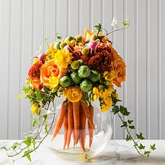 Mix up traditional floral arrangements with a bouquet of bright carrots at the heart of this more subtle Easter-inspired piece.