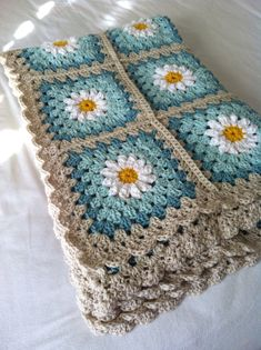 Daisy crochet blanket- this wasn't pinned properly to begin with, so it is only the picture, no one to credit or anything. But it is so beautiful, I'm going to try to figure it out. So far I have noticed that there are 12 petals on these daisies, unlike many with only 8.  Oh, found the link, yay!