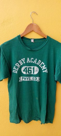 VINTAGE VTG CHAMPION RUNNING MAN BLUE BAR 60'S 50'S DERBY ACADEMY GREEN T SHIRT
