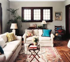 Inject personality into neutral sofas by adding brightly patterned and colored throw pillows. | Surprising, low-cost ways to update your home décor.