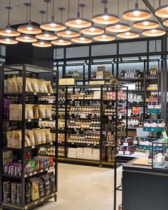 Shinsegae's  supermarket, completely pristine and looking more like set design than a real working grocery store. then in another section, packaged foods. The look of this section reminds one a lot of Le Bon Marche's food market in Paris.