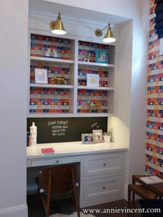 Street of Dreams Arizona - Via Annie Vincent Interiors - Amazing teenagers homework room with Osborne and Little Penguin Books Wallpaper on the walls and highlighting the back of built-in shelves over a built-in desk.
