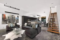 Carrera by Design created a spectacular interior design combining different materials in colors such as white, black and natural wood - CAANdesign | Architecture and home design blog