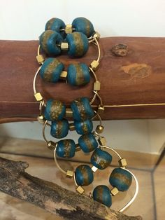 A personal favorite from my Etsy shop https://www.etsy.com/listing/268446528/african-teal-gold-kente-glass-bracelet