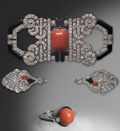 An Art Deco parure, circa 1925. Consisting of a brooch, a jabot pin and a ring, and composed of platinum, coral cabochons