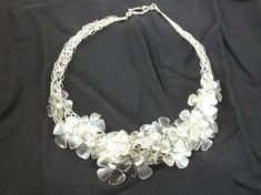 This is one of my treasures...Necklace made from recycled plastic bottles. Idea sent by Célia Machado !…
