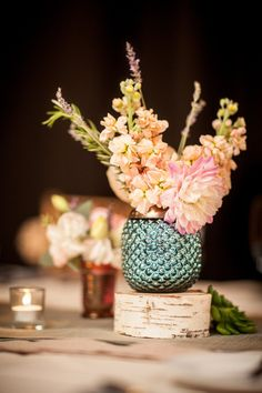 Use smaller metallic vases for your florals instead of large centerpieces - still a big impact. Photography by twinlensimages.com, Event Planning by jessiebaca.com, Floral Design by artichokesandpomegranates.com, Read more - http://www.stylemepretty.com/2013/06/19/santa-fe-wedding-from-twin-lens/