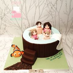 Hot tub cake , fondant, handmade edible people figures with edible fish inflatable.