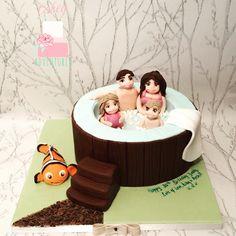Hot tub cake , fondant, handmade edible people figures with edible fish inflatable.