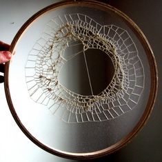 i'm seeing this done differently...not sure which direction yet. needs exploring. cotton thread on a single layer of tulle in an embroidery hoop by Monikah…
