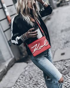 WEBSTA @ mikutas - Red 💥 Back in Berlin with the Karl signature bag for a pop of colour and stripes ❤ @karllagerfeld #ootd #karllagerfeld #ad