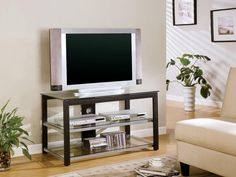 Coaster Furniture Rectangle Media Console with Glass Shelves. Crafted of glass and metal. Black and silver finish. 2 Large open shelves. Maximum TV Size: 42 in. Holds up to 50 lbs.