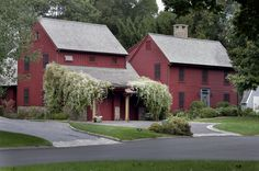red exterior with red trim and dark windows, farmhouse exterior by Michael Piccirillo Architecture PLLC
