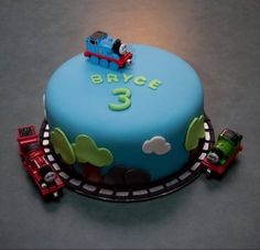 Thomas Birthday Cake. Simple and not overly Thomas. Just wash toys and place on and around cake