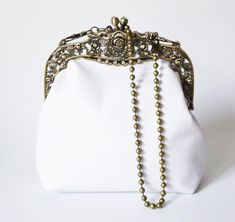 Exclusive #white #bridal leather #handbag with bronze color metal purse frame and bronze pearl strap. Of course it's also a beautiful, great #eveningbag. Minimalist, elegant ... Customized Gifts, Personalized Gifts, Leather Photo Albums, Gadgets, Clutches For Women, Pearl Chain, Hair Jewelry, Decoration, White Leather