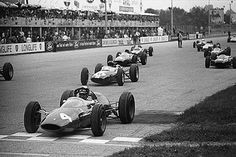 """British driver John Surtees became 1964 F1 World Champion in a Ferrari 158 with a 205B V8 engine. Scuderia Ferrari would not have another champ until 1975 with Niki Lauda. Before F1, Surtees was a World Champion motorcycle racer. He remains the only pilot to have been Champ on both 2 and 4 wheels. Photo - """"Monza , September 1963: On pole position, John Surtees prepares for the start of the Italian Grand Prix. He would retire his Ferrari on lap 17 with engine problems. © Schlegelmilch"""""""