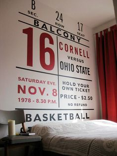"fabulous wall graphics. perfect for sports or college dorm decor. via apartmenttherapy. ""Using inspiration from a vintage ticket stub, we designed this decal. We had it printed as a large black and a red wall sticker, which we cut in approx. 20 pieces and applied to the wall. We used some dates and numbers that mean something to us (including our anniversary date) to make it even more personal."""
