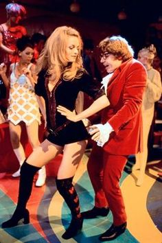 Mike Myers and Heather Graham. Oh Be-have.... Austin Powers The Spy who Shagged Me (1999)..... And great memories with Harry-O!