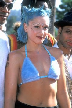 90s Beauty Trends You Need To See:  Gwen Stefani—in her early 'No Doubt' phase—with short pastel blue hair, brown lipstick, and gems glued to her face | BeautyHigh.com