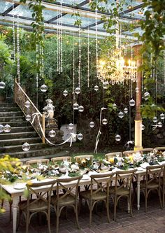 Love the hanging glass balls. Potential candle lighting idea in addition to the chandeliers.