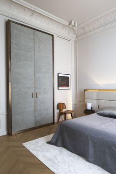 Apartment in the Trocadéro area of Paris in warm, limited palette of medium tone woods, timeless Calacatta marble, and warm brushed bronze. Work of designer Rodolphe Parente