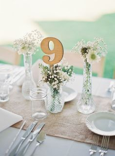 inspiration | BHLDN wooden table numbers in tiny bud vases | via: style me pretty