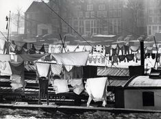 1950's. Wash day on board of the freight vessels in a canal in Amsterdam. In the foreground De Christina. Photo K.v.d. Lei. #amsterdam #1950