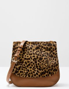 "$168 Boden Pony Saddle Bag     Outer animal print hair on cowhide and leather     Printed lining 100% cotton     24cm/9½"" wide at base x 23cm/9"" high x 9cm/3½"" deep, total strap length at middle hole 113cm/44½""     Comes with its own fabric storage bag     Inside slip and zip pockets     Magnetic fastening     Adjustable strap"