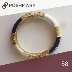 Navy Blue, White and Gold Bracelet Bracelet has spring clasp close. I think it is Anne Klein but not 100% sure. Jewelry Bracelets