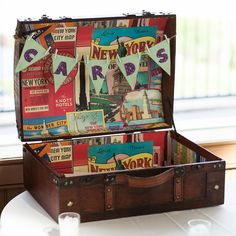 A vintage suitcase plastered with NYC iconography was a memorable highlight from a wedding reception with a view of the Manhattan skyline.