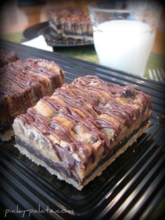 Layered Cookie Bar with 4 different cookie doughs!  #cookies #bars #dessert