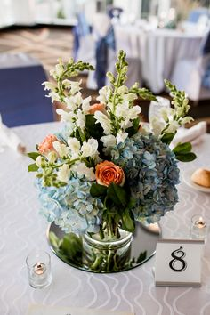 Flowers by Sisters Floral Design Studio www.sistersflowers.net Image by Kathleen Mortland Photography #sistersfloraldesignstudio #weddingflowers #receptionflowers #centerpiece #bluehydrangea #peachroses #snapdragons Centerpieces, Table Decorations, Blue Hydrangea, Flower Designs, Wedding Flowers, Floral Design, Sisters, Reception, Studio