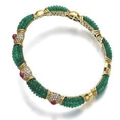 Best Diamond Bracelets : Emerald, ruby and diamond choker The flexible collar set with rows of emerald beads, alternating with gold links, the front set with three cabochon rubies and pavé-set with brilliant-cut diamonds, Italian assay mark. Emerald Necklace, Emerald Jewelry, Gems Jewelry, Sea Glass Jewelry, High Jewelry, Jewelry Art, Jewelery, Diamond Jewelry, Diamond Choker