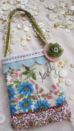 Pocket sized bag made from vintage handkerchief.