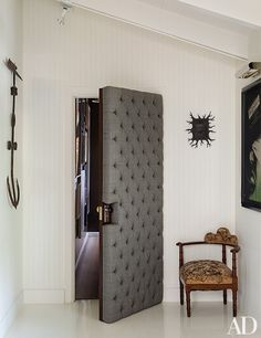 Button-tufted suiting fabric upholsters the door between Kopelman's suite and a hall to the home's master bedroom. A small Mark Ryden painting in a hand-carved frame hangs above an antique English chair; the anchor, at left, is also antique. Home Studio Musik, Music Studio Room, Sound Studio, Home Music Rooms, Home Theater Rooms, Deco Studio, Drum Room, Recording Studio Design, Easy Home Decor