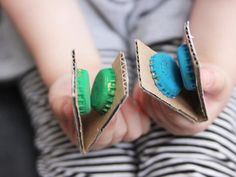 Let your kids explore their musical side with these mini instruments made out of caps and cardboard. Each kid gets to pick their own color!