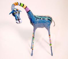 giraffe...possibly make with clay and nails for the legs?