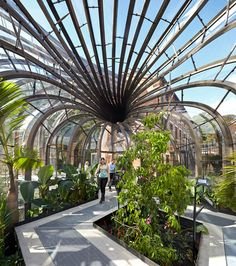 British designer Thomas Heatherwick has completed work on a new complex for gin company Bombay Sapphire in Hampshire, England, including two sculptural glasshouses that are heated using warm air created during the distilling process