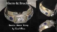 Center = .38 carat d vs2 eightstar  2 sapphires sourced from Madagascar  4 x .10 ct. e vs1 ACA accent stones    Two tone custom band with 18 kt yellow gold & 18 kt white gold    Posted by Colored Gemstone Nut
