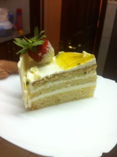 Slice if passion fruit cake with white chocolate mousse filling!