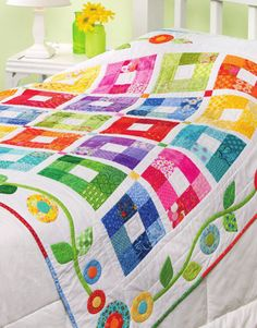 Bright and cheerful quilt - love the border