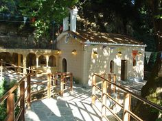 www.vasiliki-village.gr/ Name Day Today, Peaceful Places, Gazebo, Waterfall, Outdoor Structures, Cabin, House Styles, Building, Outdoor Decor