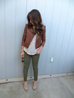 Olive crop pants, black/white stripe shirt, brown leather jacket, nude shoes.