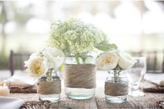Twine around glass vases. I'm going to do this the glass salsa bottle we just finished!