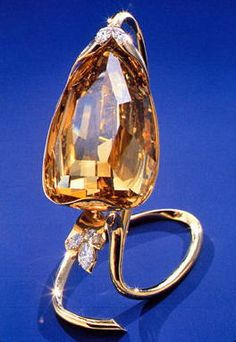The Incomparable Diamond, a virtually flawless brown and unusually faceted diamond of 407.48 carats, cut from an 890 carat stone. 14 other stones resulted from cutting the original stone: the largest being 15.66 carats, the smallest, 1.33 carats. Worth looking at the website to read its fascinating story.