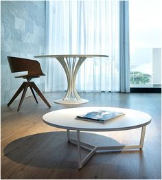 Alivar's modern lacquered coffee table Harpa, and stylish Radar dining table http://www.uber-interiors.com/Alivar/alivar-harpa-72-coffee-table