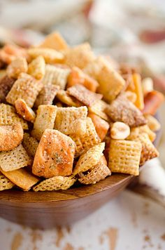 Zesty 3 Cheese Snack Mix is the perfect treat for the holidays with Chex Mix, nuts, cheesy crackers and pretzels coated in ranch seasoning, Parmesan and butter!